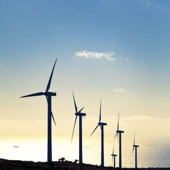 Photo of Wind Turbines against blue sky