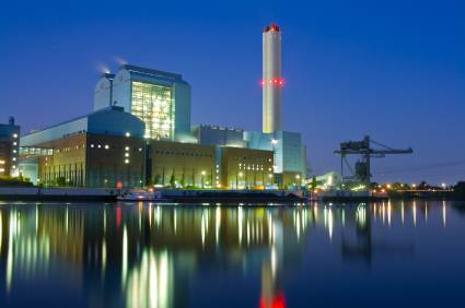 Power generation plant by waterfront at night